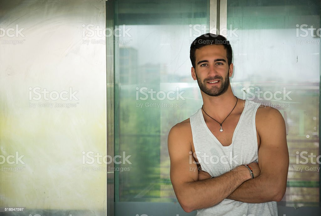 Handsome bearded young man outdoors in urban environment stock photo
