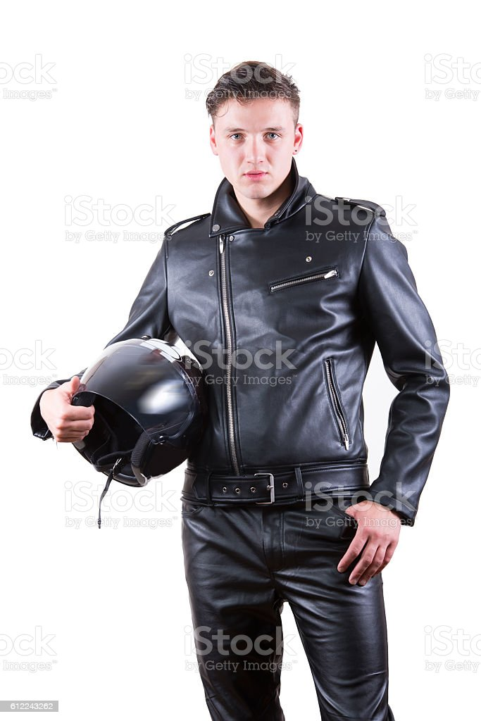 handsome biker man wearing black leather jacket holding motorcycle helmet stock photo
