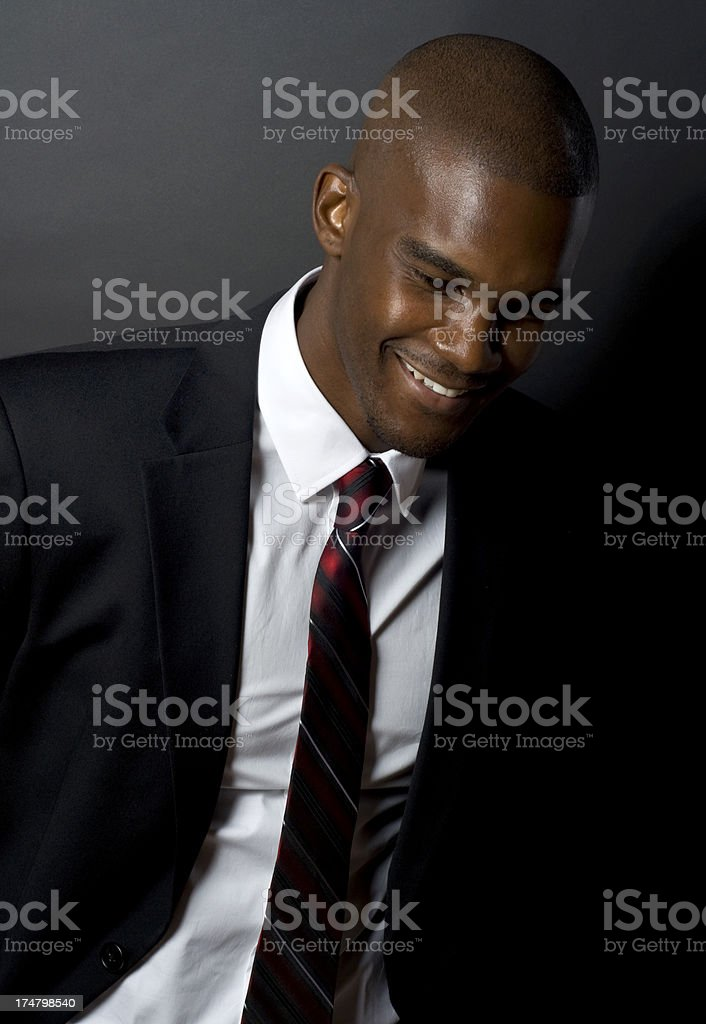 Handsome Black Male Model In Business Suit and shaved head