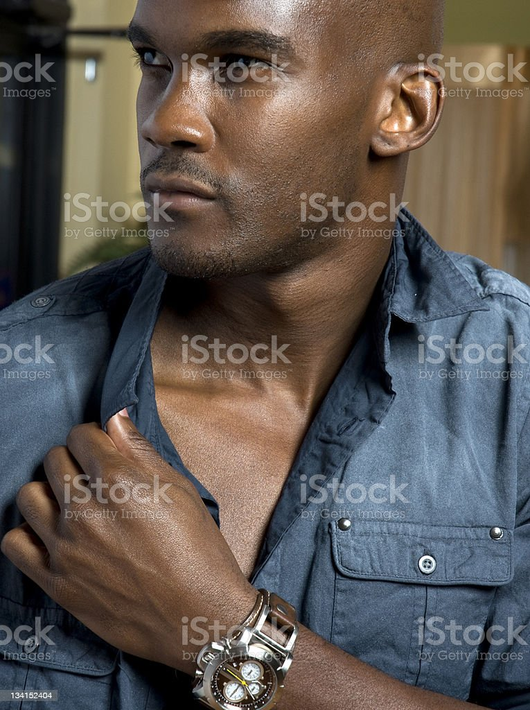 Handsome Black Male Model In Denim With Wristwatch stock photo