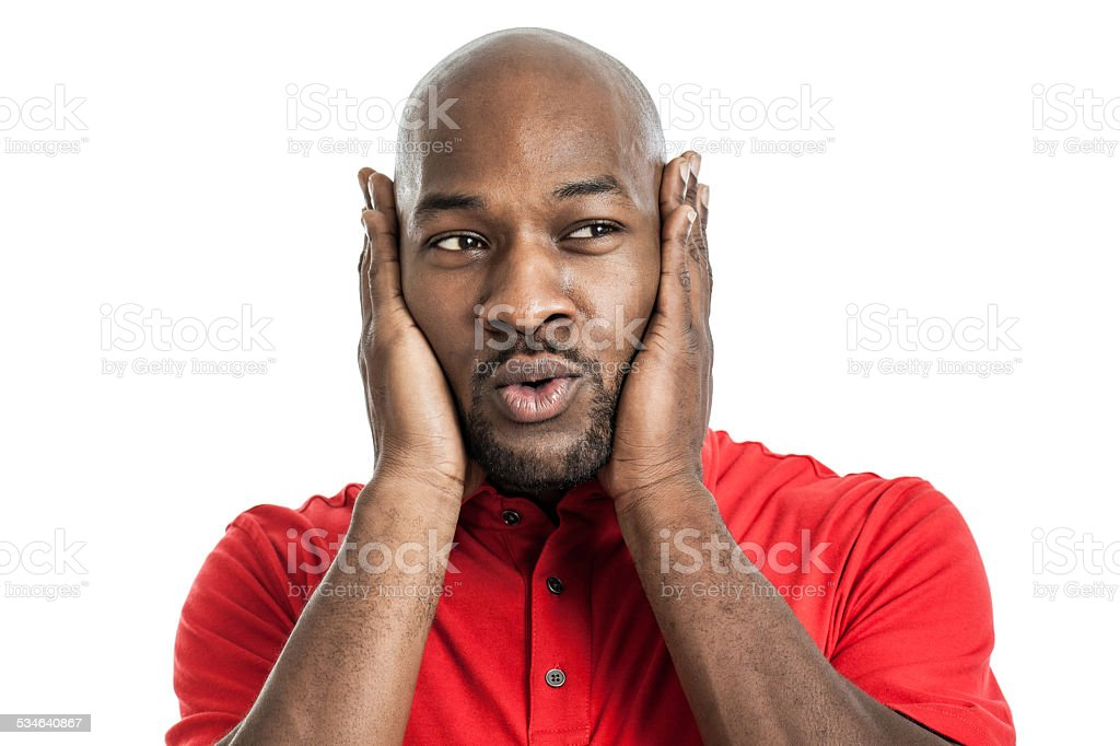 Handsome black man covering ears stock photo
