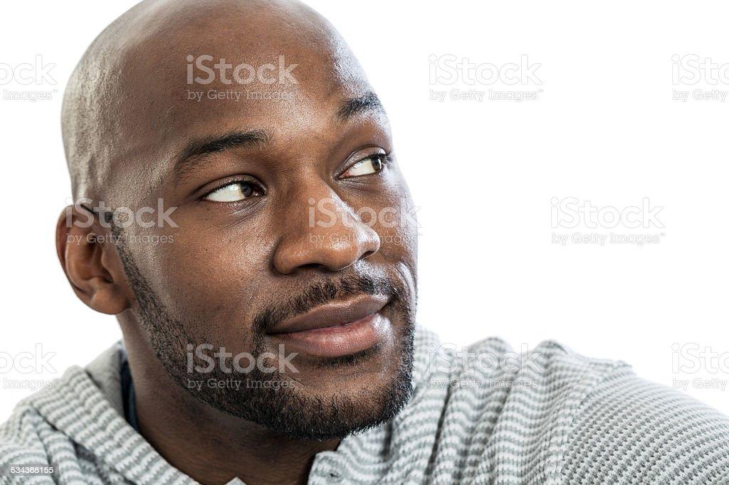Handsome black man looking over shoulder stock photo