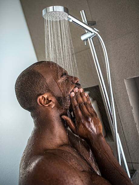 Handsome Black Man Taking a Shower stock photo