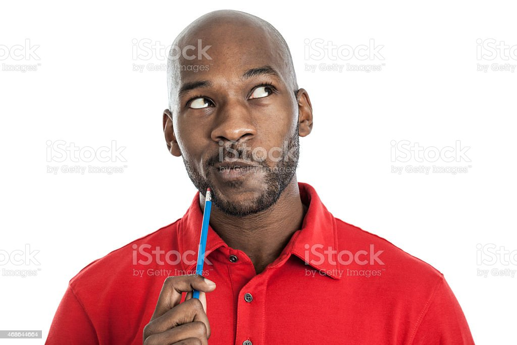 Handsome black man thinking stock photo