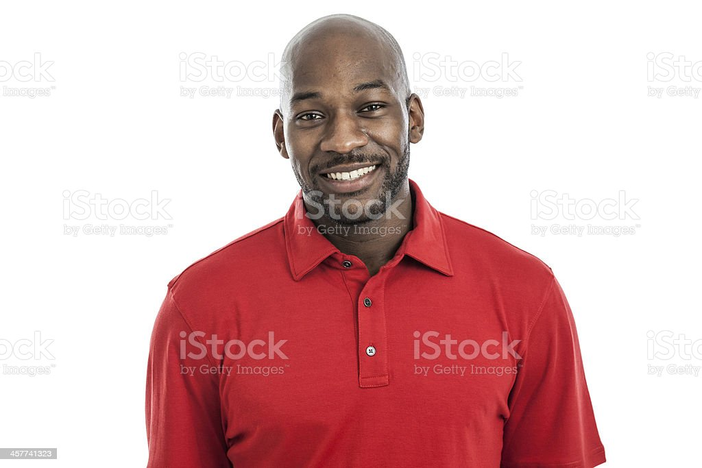 Handsome black man wearing a red shirt smiling into camera stock photo