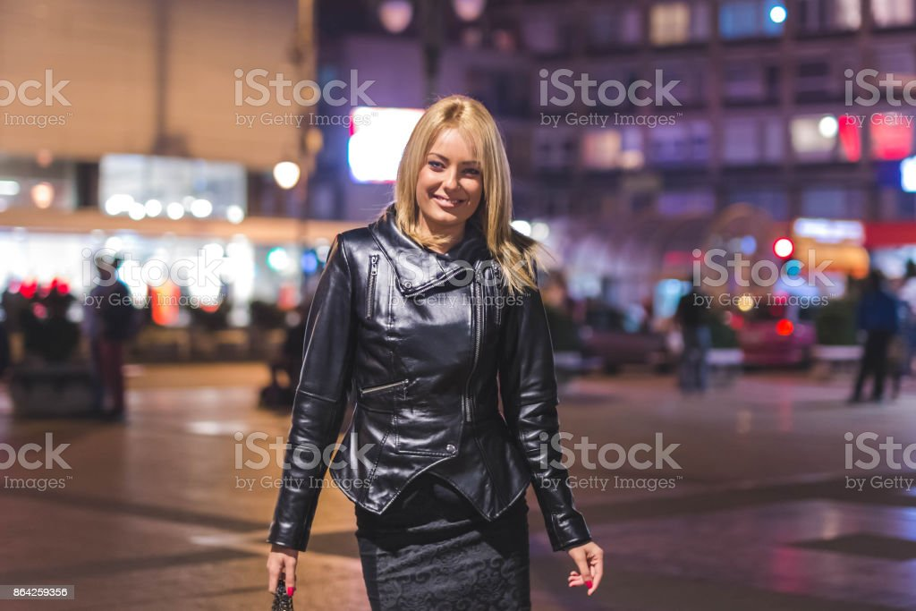 Handsome blonde businesswoman walking in the city royalty-free stock photo