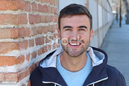 Handsome blue eyed man smiling outdoors.