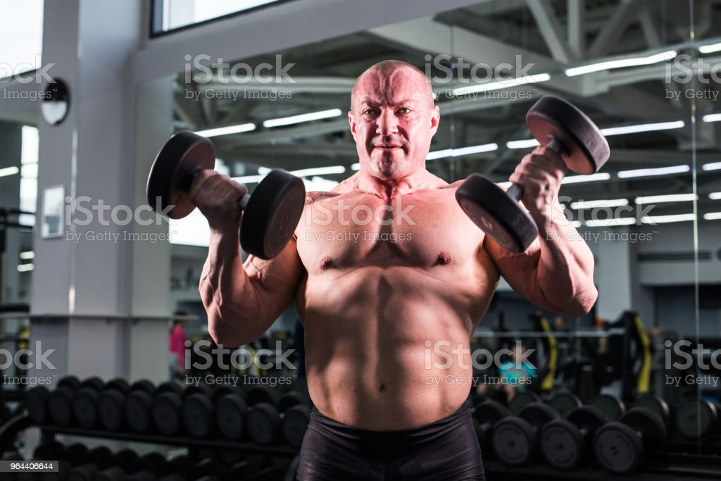 Handsome bodybuilder man with big muscles in the gym - Royalty-free Adult Stock Photo