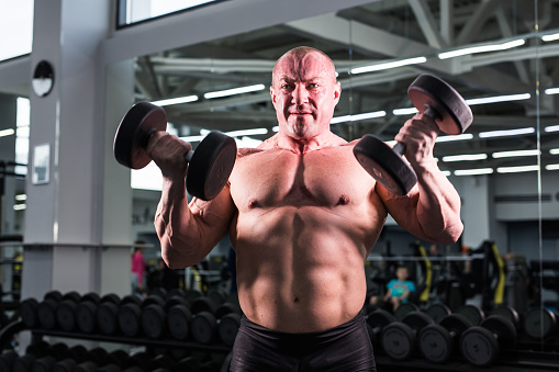 Handsome Bodybuilder Man With Big Muscles In The Gym Stock Photo - Download Image Now