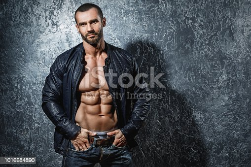 Handsome bearded bodybuilder showing his muscular body