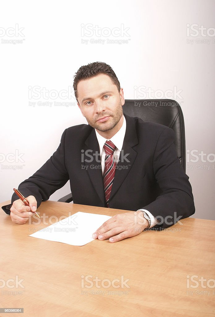 handsome boss sitting at the desk - Royalty-free Agreement Stock Photo