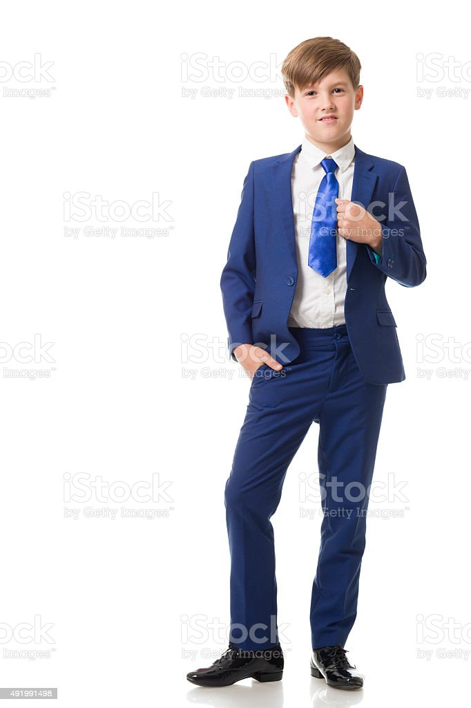 Handsome boy in blue suit posing stock photo