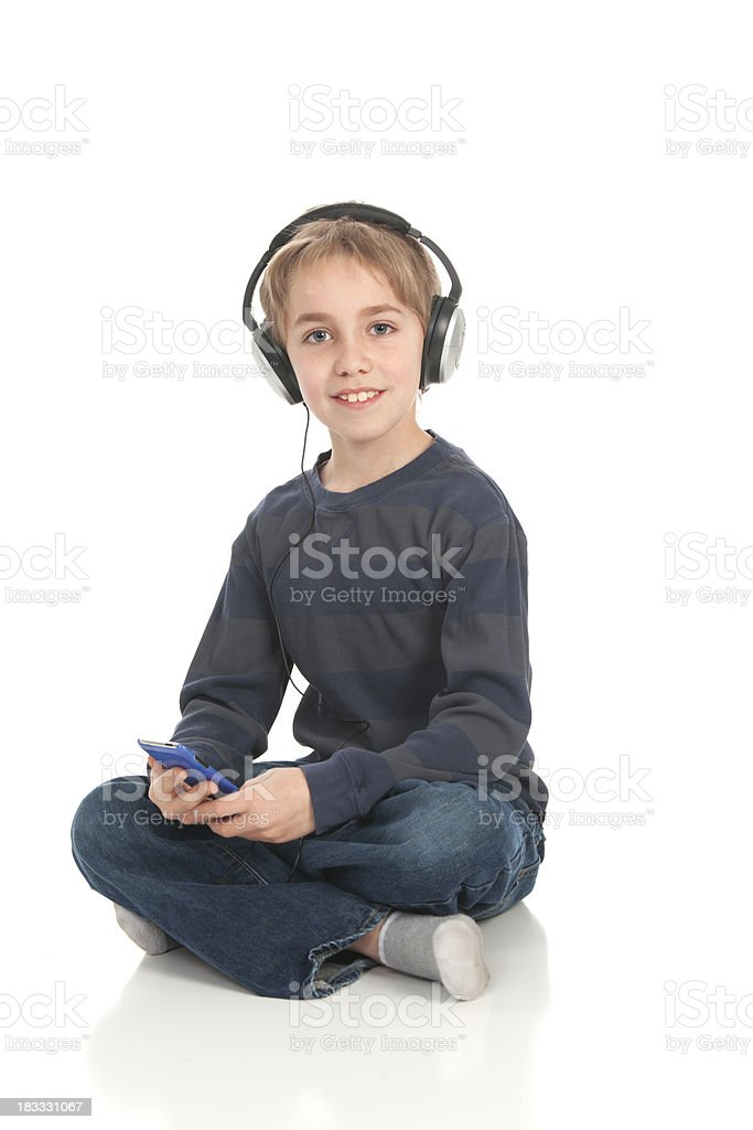 Handsome boy listening to MP3 player stock photo