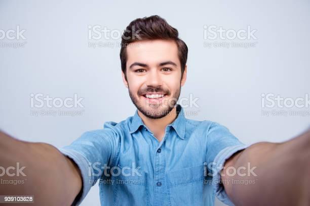 Handsome brunet young man is making selfie and smiling he is wearing picture id939103628?b=1&k=6&m=939103628&s=612x612&h=chkw cbmel5wqbravukir3 c3jrqq0bt3haztustknk=