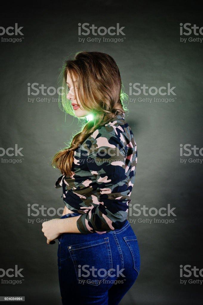 Handsome brunette girl posing at studio stock photo