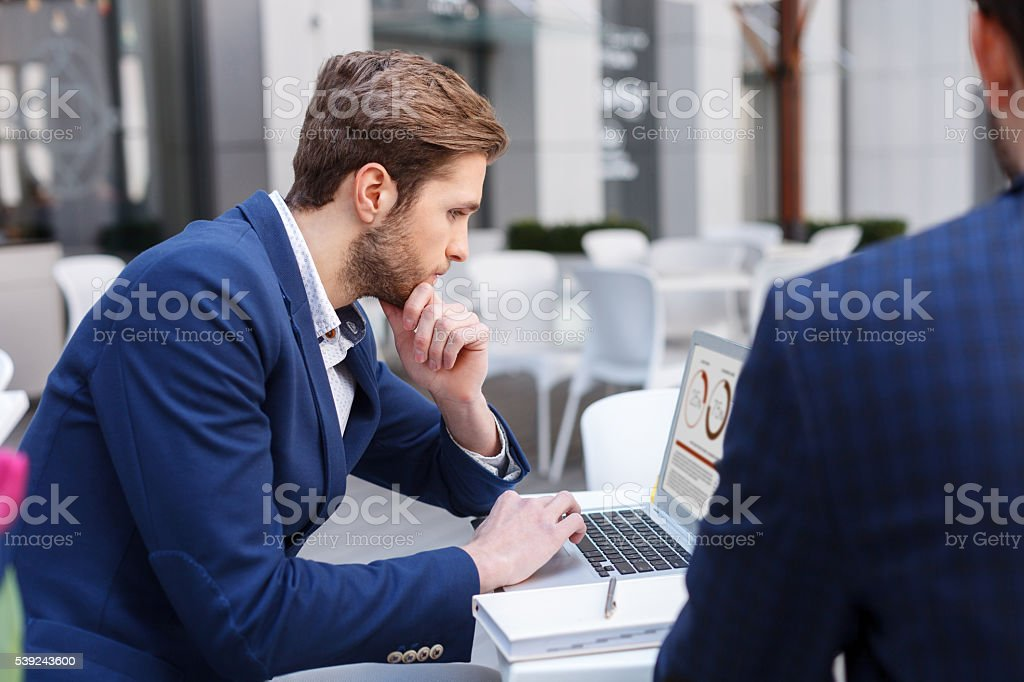 Handsome business colleagues are using laptops royalty-free stock photo