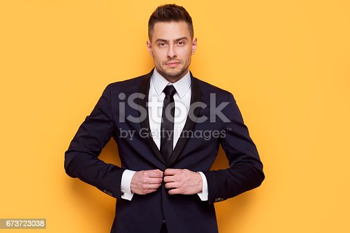 istock Handsome business man in a business suit 673723038