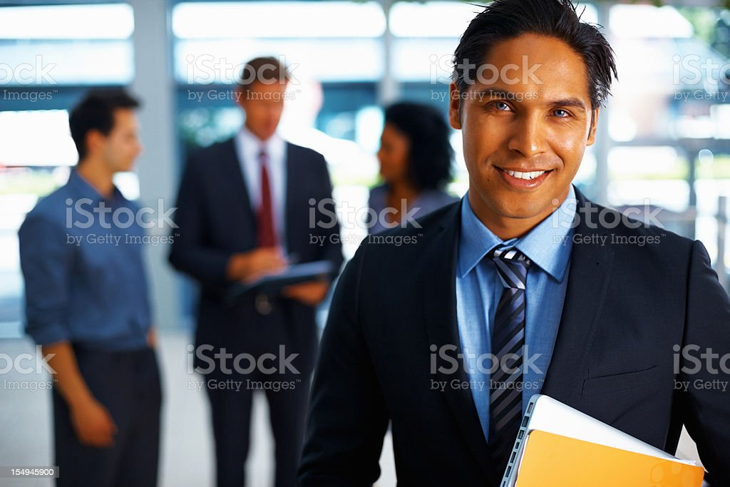 Handsome business man looking confident royalty-free stock photo