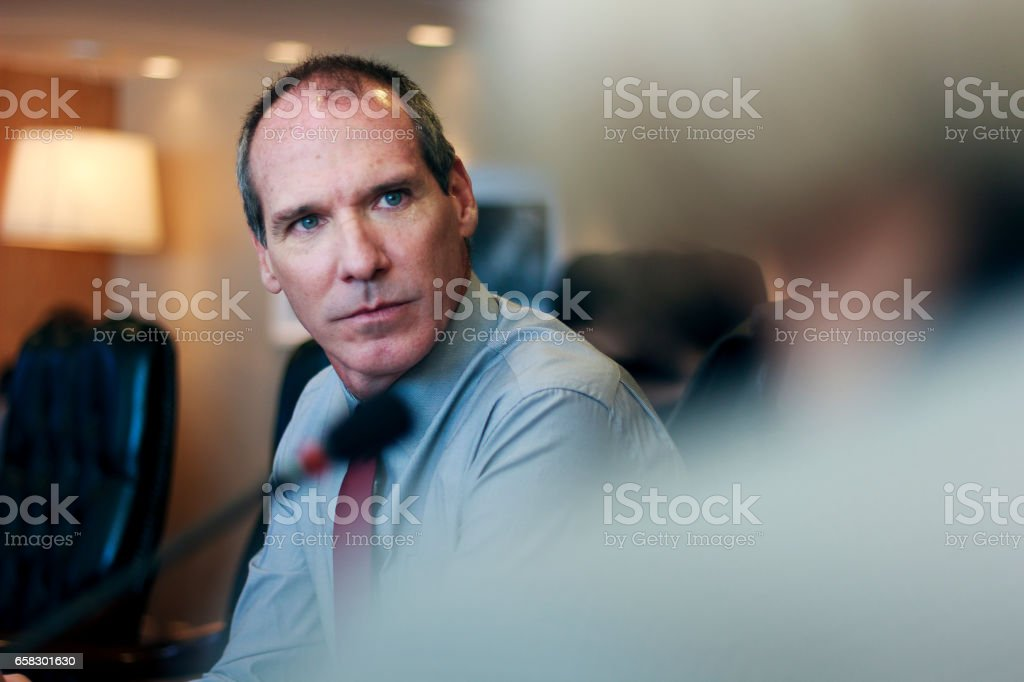 Handsome Business man on a meeting stock photo
