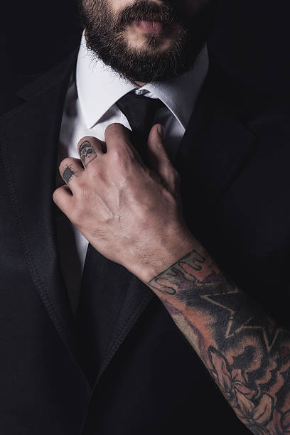 handsome business man - tattoo stock photos and pictures