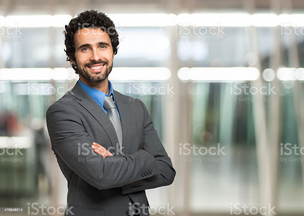 handsome-business-man-posing-for-a-portr