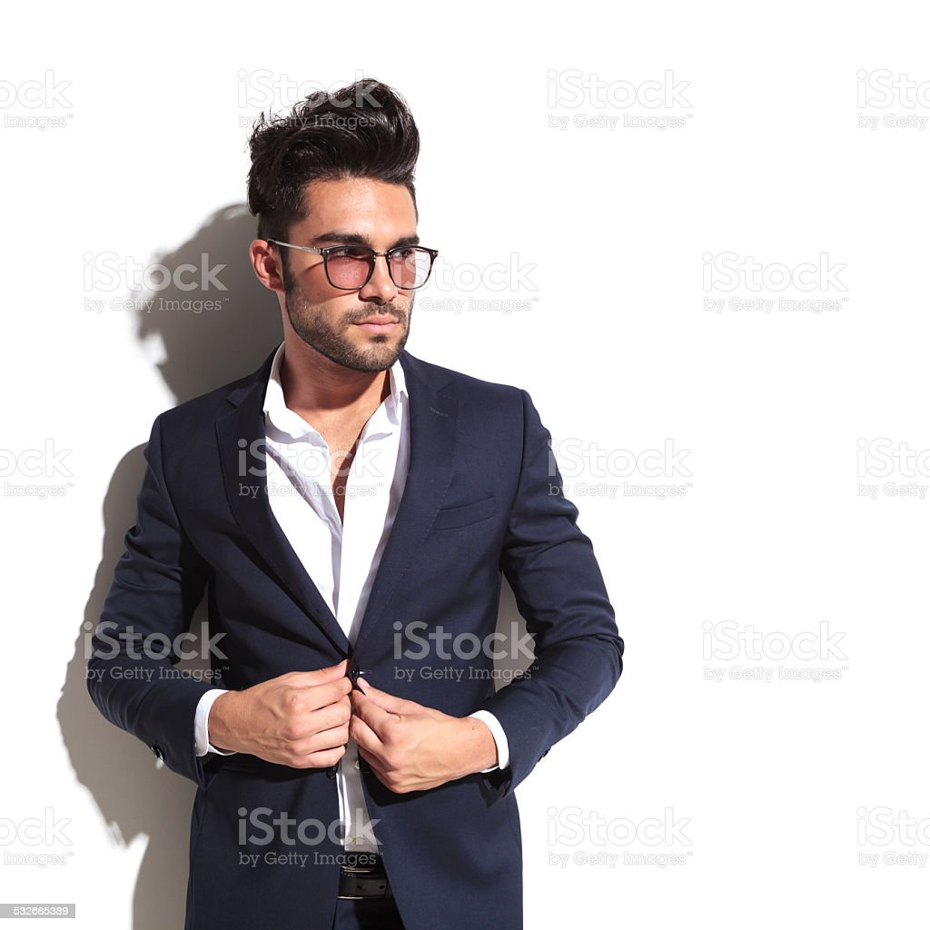 Handsome business man unbuttoning his jacket stock photo