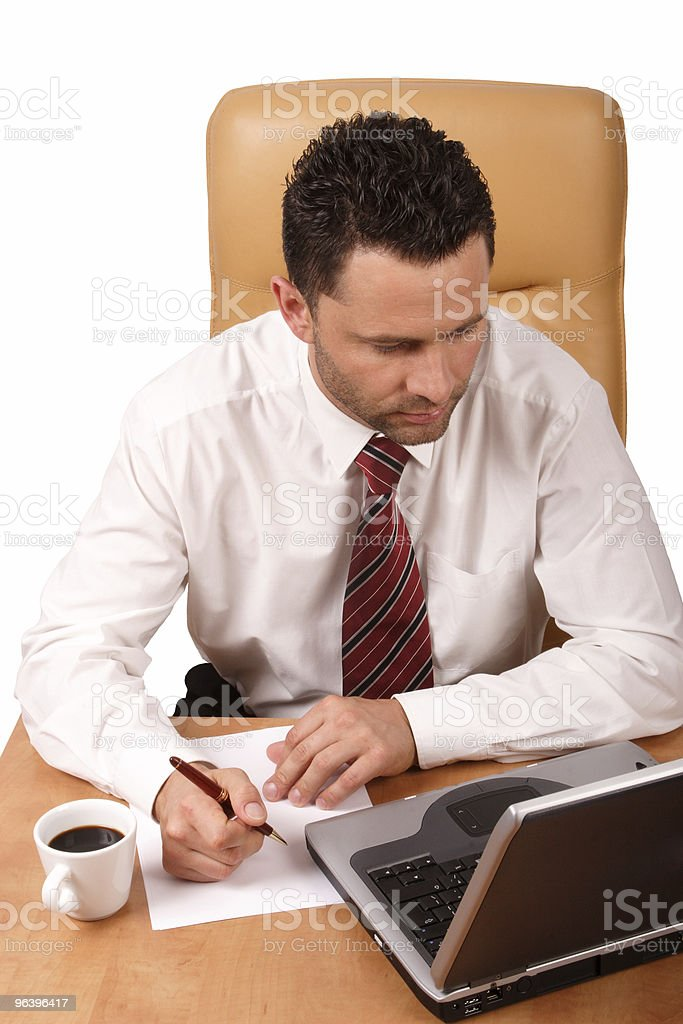 Handsome business man working with laptop in his office royalty-free stock photo