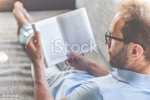 istock Handsome businessman at home 612741540