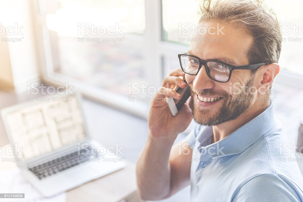 Handsome businessman at home stock photo