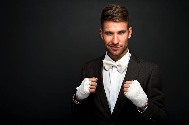 Handsome businessman boxer stock photo