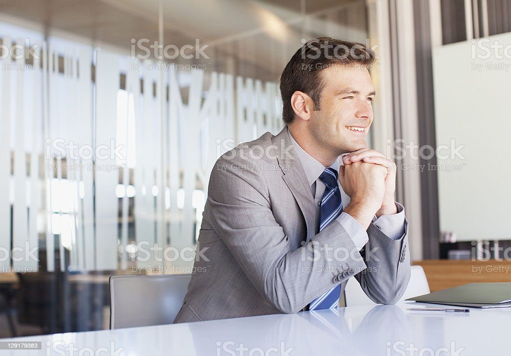 Handsome businessman daydreaming royalty-free stock photo