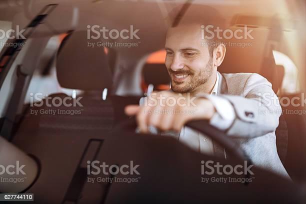 Handsome Businessman Driving Car Foto de stock y más banco de imágenes de Adulto