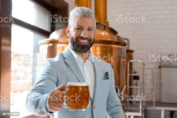 Handsome Businessman Holding A Beer Mug In Microbrewery Stock Photo - Download Image Now