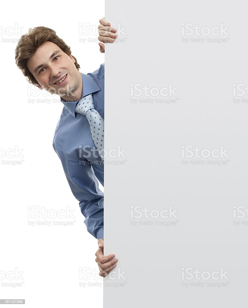 Handsome Businessman holding a blank sign royalty-free stock photo