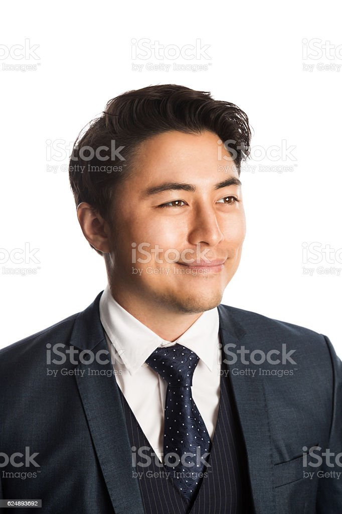 Handsome businessman in a blue suit and tie looking away stock photo