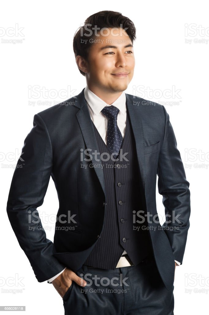 Handsome businessman in a blue suit and tie stock photo