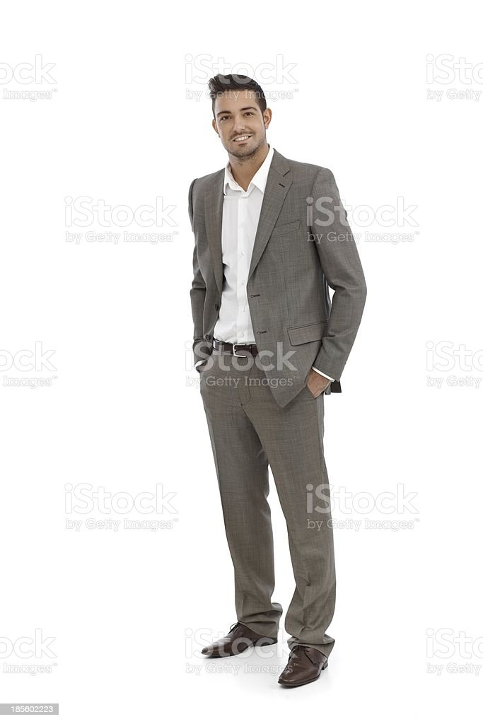 Handsome businessman in grey suit stock photo