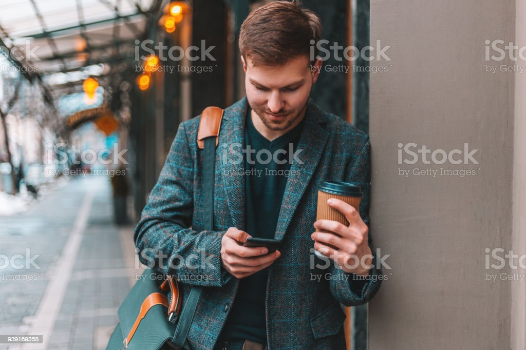 Handsome businessman in the city stock photo
