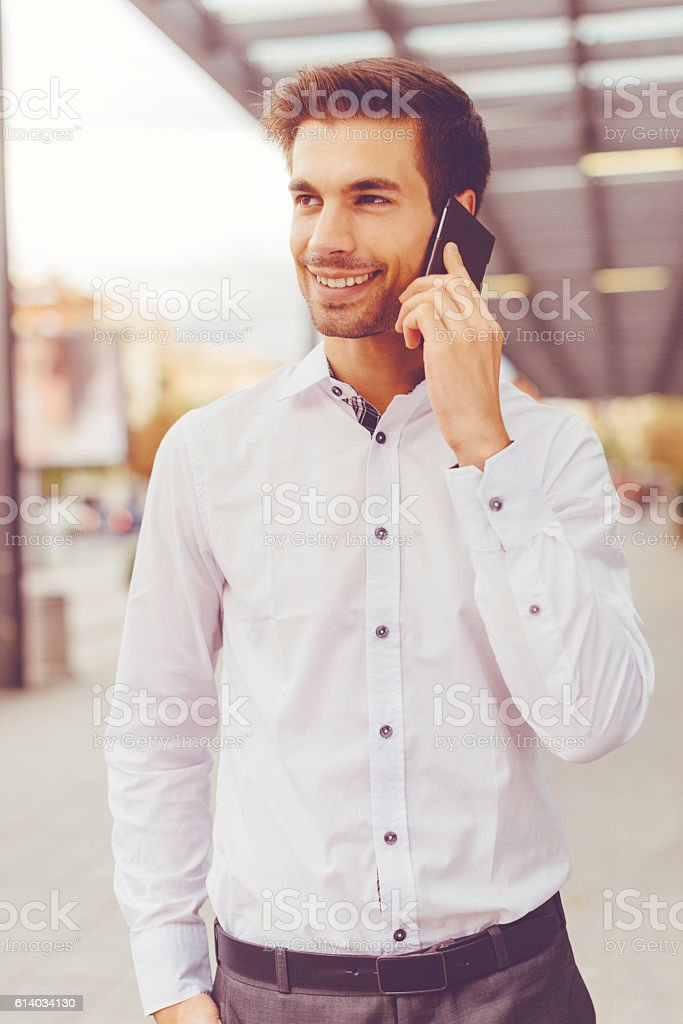 Handsome businessman in white shirt discussing investments stock photo