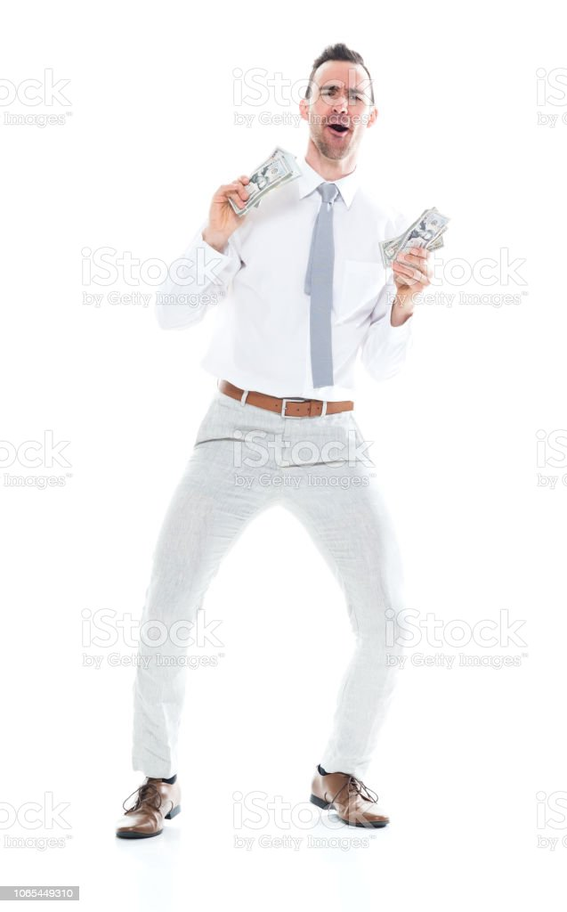 Handsome businessman is holding cash and is very excited stock photo