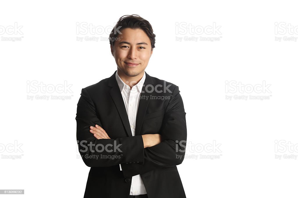 Handsome businessman looking at camera with arms crossed stock photo