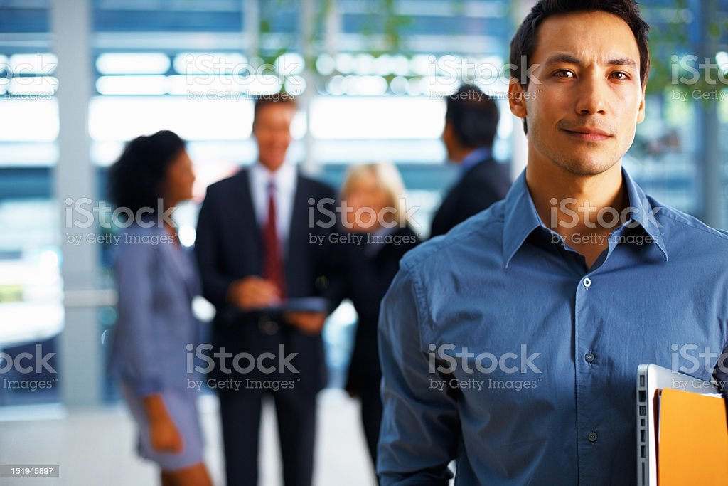 Handsome businessman looking confident royalty-free stock photo