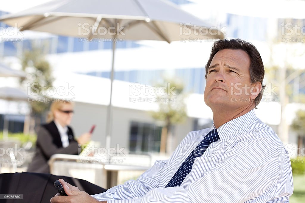 Handsome Businessman Looks Off Into the Distance royalty-free stock photo