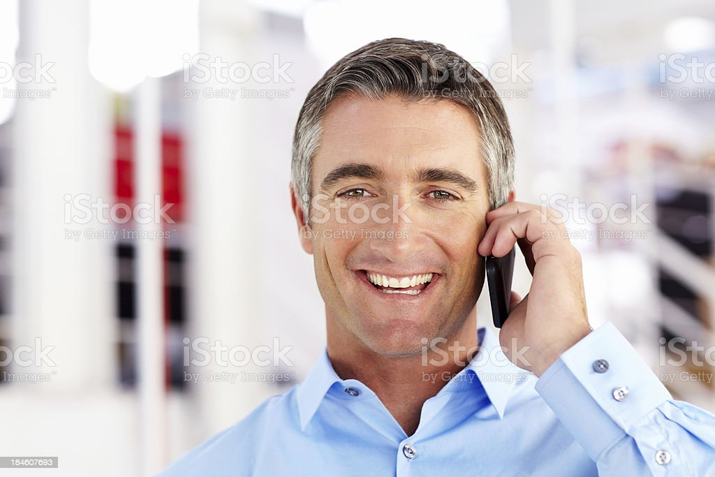 Handsome Businessman on a Cellphone royalty-free stock photo