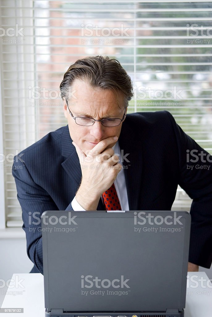 handsome businessman on computer royalty-free stock photo