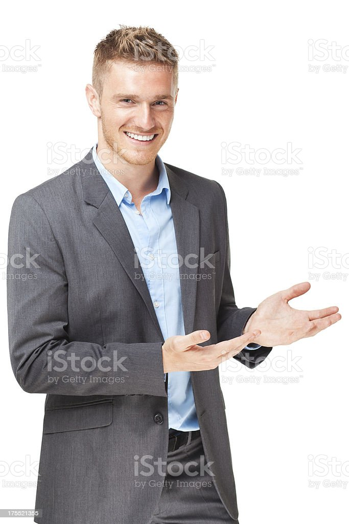 Handsome businessman presenting over white background stock photo