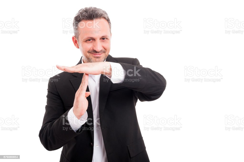 Handsome businessman showing time out royalty-free stock photo
