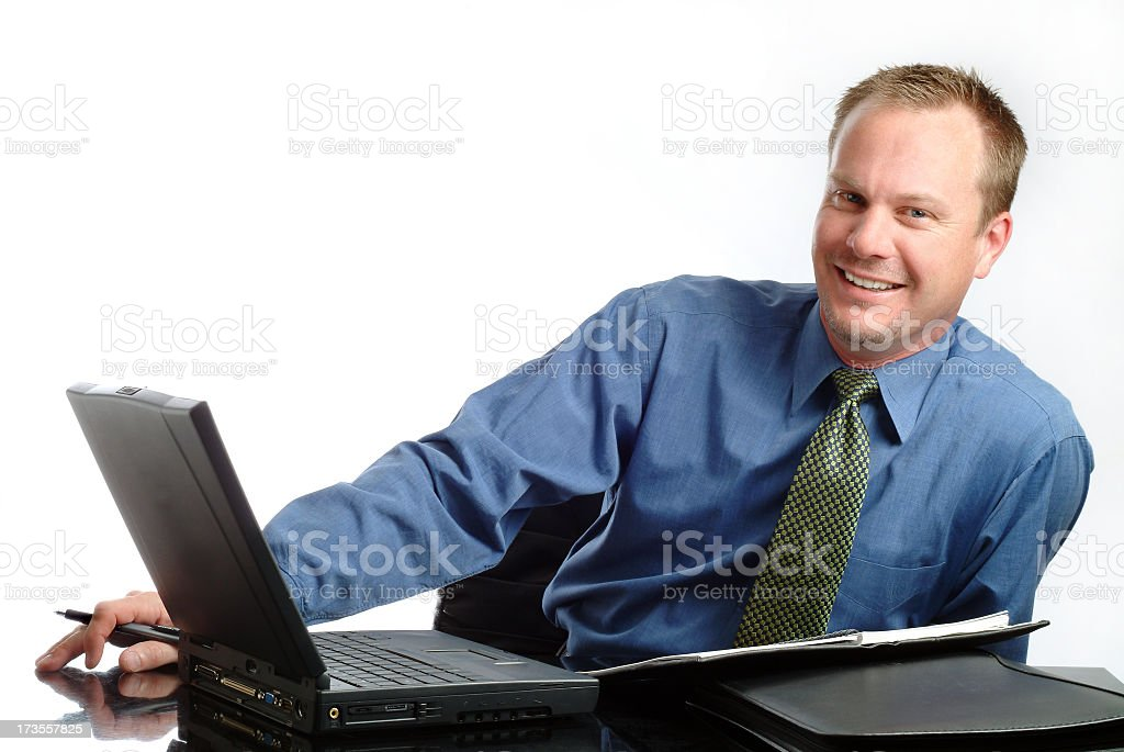 Handsome Businessman Sitting at his Desk Offering Assistance royalty-free stock photo