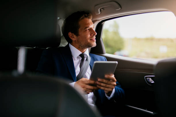 handsome-businessman-sitting-with-digital-tablet-on-the-backseat-of-picture-id1165712069?k=6&m=1165712069&s=612x612&w=0&h=OPHOyuyaygZoThTudQlScizpqcLHRJx9_o_QDY7qH-8=