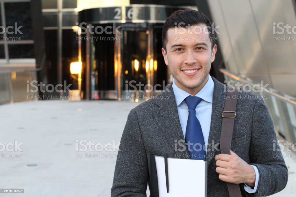 Handsome businessman smiling outside the office building royalty-free stock photo